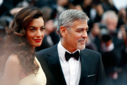 """CANNES, FRANCE - MAY 12: Actor George Clooney and his wife Amal Clooney attend the """"Money Monster"""" premiere during the 69th annual Cannes Film Festival at the Palais des Festivals on May 12, 2016 in Cannes, France. (Photo by Tristan Fewings/Getty Images)"""