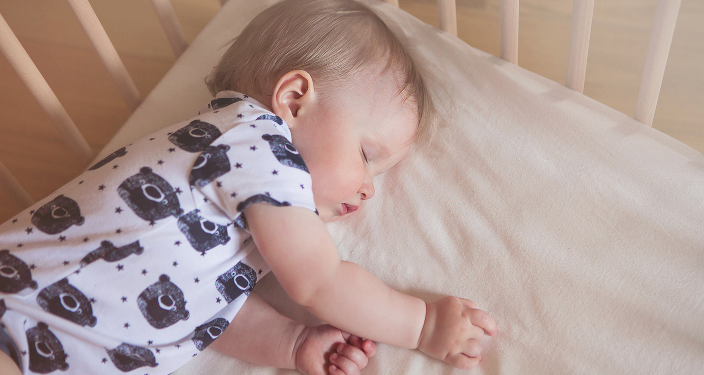 Peaceful adorable baby sleeping on his bed in a room. Soft focus. Sleeping baby concept. year-old babyboy sleeps at home