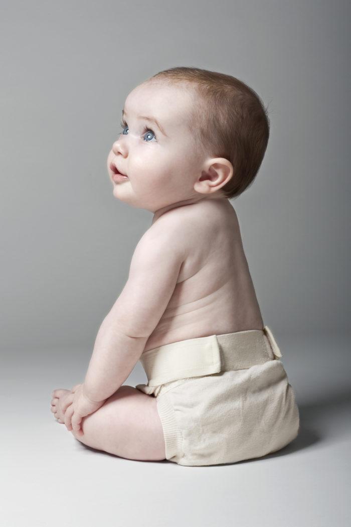 Baby in a reusable cloth diaper